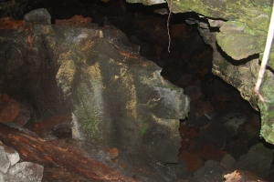 The entrance to Pele's womb is at the bottom of a cliff